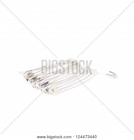 Bunch of metal safety pins isolated on white background