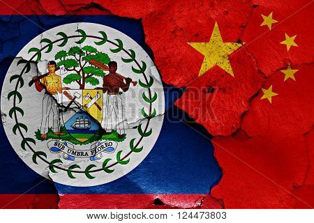 flags of Belize and China painted on cracked wall