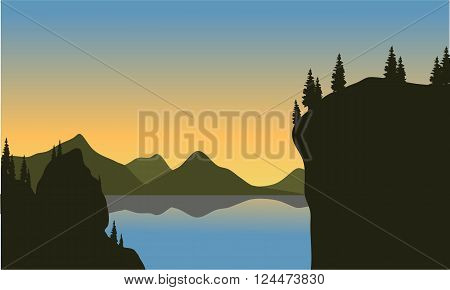 Silhouette of cliff on the lake at afternoon