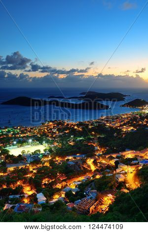 Virgin Islands St Thomas sunset mountain view with colorful cloud, buildings and beach coastline.