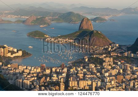 Panoramic view of Rio de Janeiro and Sugar Loaf mountain from Corcovado at Sunset