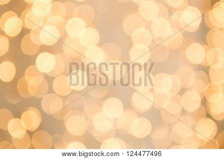 Colorful defocused circular bokeh background with twinkling blurred lights. Christmas Glitter Defocused light.