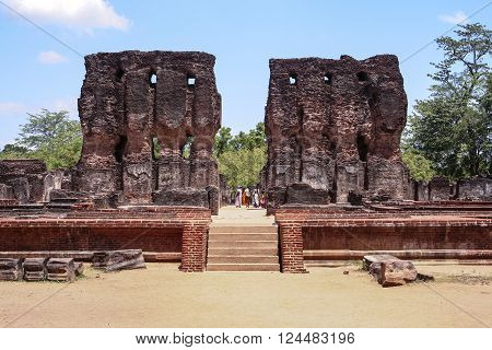 POLONNARUWA SRI LANKA - AUG 6 2005: people visit famous kings temple in Polonnaruwa Sri Lanka. It was built by king parakramabahu the great.