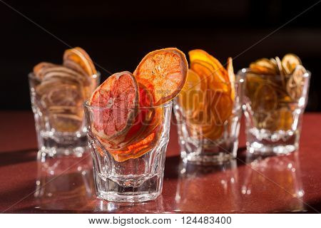 Assorted Cookies and Citrus Fruit Chips, dried citrus chips in a glass