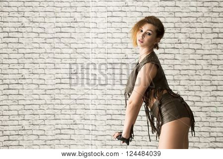 beautiful girl dancing go go. against the background of a brick wall
