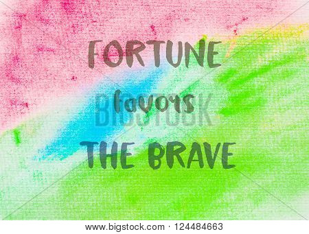 Fortune favors the brave. Inspirational quote over abstract water color textured background