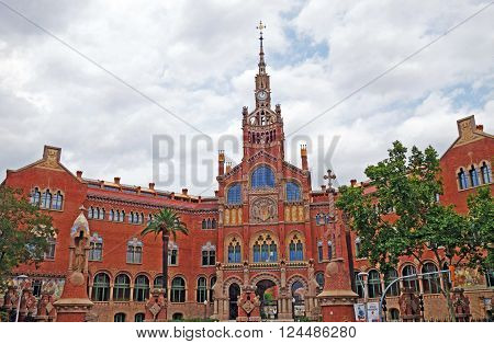 BARCELONA, SPAIN - JULY 31, 2015: View of the famous historical complex of former monastery and hospital Sant Pau Recinte Modernista, built between 1905 and 1930, designed by Lluis Domenech i Montaner