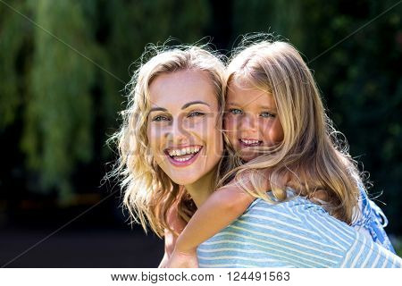 Close-up of happy mother with daughter in yard