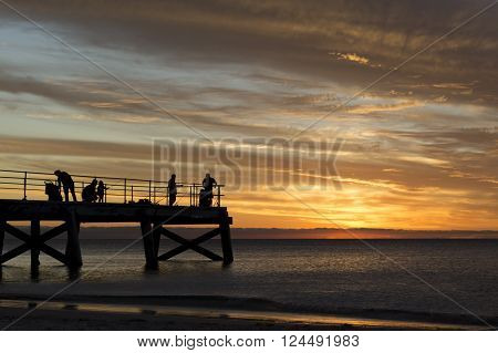Sillouetted People Fishing - Normanville Jetty At Sunset