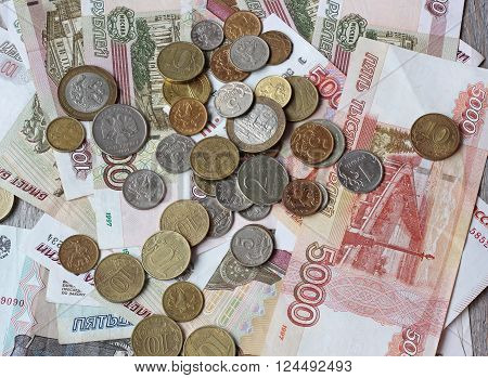 Russian paper and metal money on wooden table top view. Rubles and kopecks.