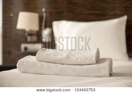 Stack Of Towels On The Bed