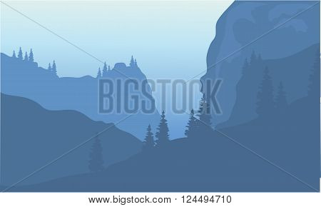 Silhouette of cliff and forest at morning
