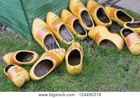 Pile of Dutch clog/Wooden Shoes outside in the rain