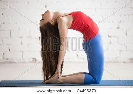 Beautiful Yoga Woman Doing Ustrasana Pose