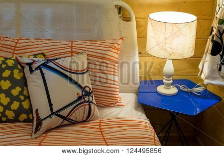 Colorful Pillows On Bed With White Lamp