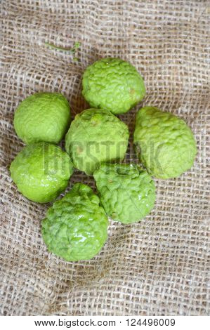 kaffir Lime or Bergamot fruit on old fabric ** Note: Soft Focus at 100%, best at smaller sizes