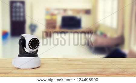 Security camera on Wood table. IP Camera