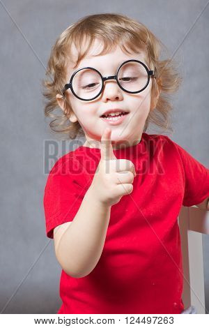 A Boy Shows His Finger. Closeup
