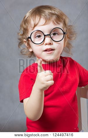 A Boy Shows His Index Finger. Closeup