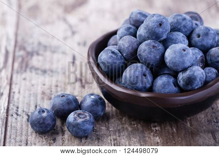 bilberries on a wooden background