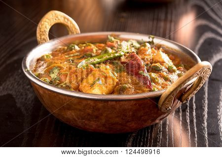 Paneer Butter Masala in a brass bowl