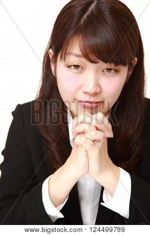 portrait of businesswoman folding her hands in prayer ** Note: Soft Focus at 100%, best at smaller sizes