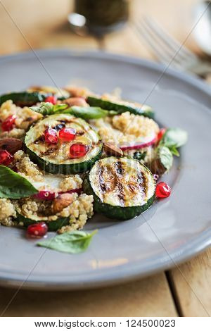 Quinoa with grilled courgette almond and omegranate salad