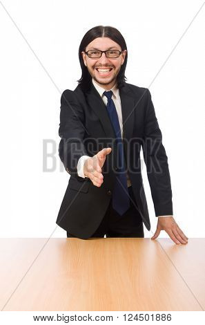 Young businessman shakes hand isolated on white