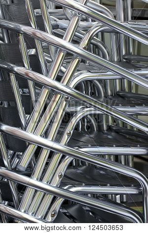 Pattern of Stacked Chairs from a street cafe