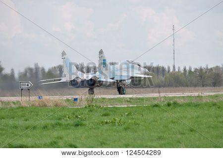Vasilkov Ukraine - April 24 2012: Ukrainian Air Force MiG-29 is taking off for a training flight