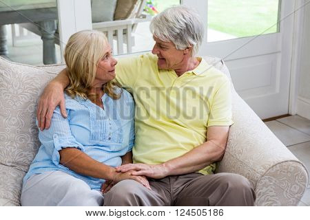 High angle view of senior couple sitting on sofa at home