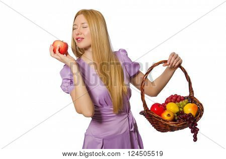 Blondie woman holding basket with fruits isolated on white