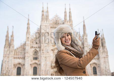 Happy Woman Taking Photos Near Of Duomo While Sightseeing Milan