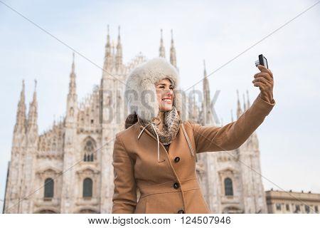 Woman Traveler Taking Selfies With Digital Camera Near Duomo