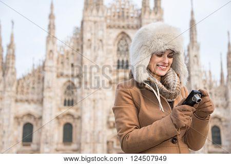 Woman Tourist Checking Photos In Digital Camera Near Duomo