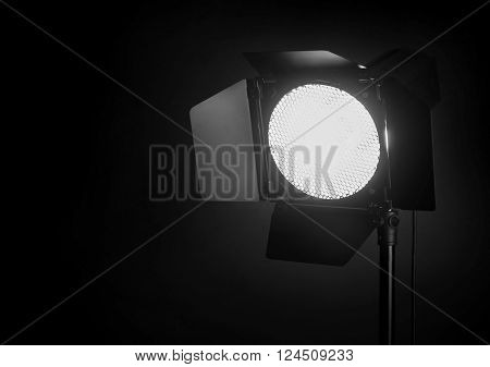 Studio flash with barndoors and grid on black background