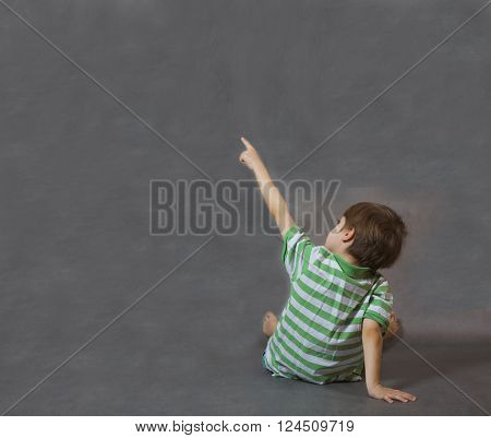 A Boy Shows Something With His Finger