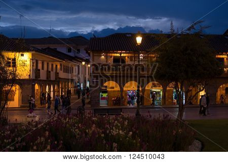 People On Main Square At Dusk, Cusco, Peru