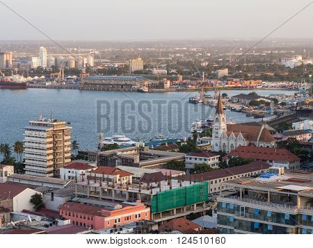 DAR ES SALAAM TANZANIA - JUNE 08 2015: Architecture in downtown of Dar es Salaam Tanzania East Africa in the evening at sunset. Horizontal orientation wide angle.