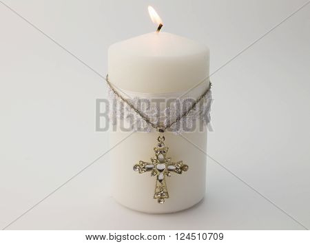 White candle with cross isolated on white background