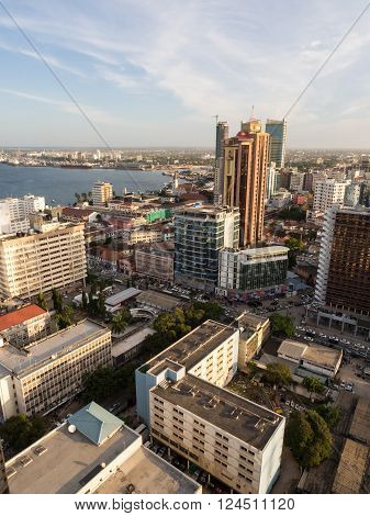 DAR ES SALAAM TANZANIA - JUNE 08 2015: Architecture in downtown of Dar es Salaam Tanzania East Africa in the evening at sunset. Vertical orientation wide angle.
