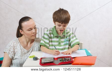 The Mother Checks The Homework Of Her Son
