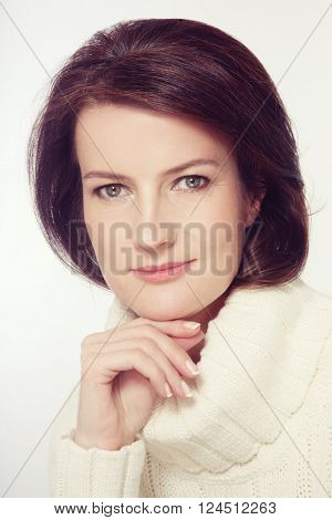 Portrait of beautiful happy smiling mature woman with clean make-up