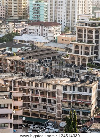 DAR ES SALAAM TANZANIA - MARCH 23 2016: Architecture in downtown of Dar es Salaam Tanzania East Africa in the evening at sunset. Vertical orientation.