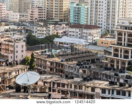 DAR ES SALAAM TANZANIA - MARCH 23 2016: Architecture in downtown of Dar es Salaam Tanzania East Africa in the evening at sunset. Horizontal orientation.