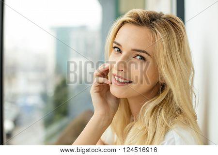 Beautiful Blonde Woman Next To A Window