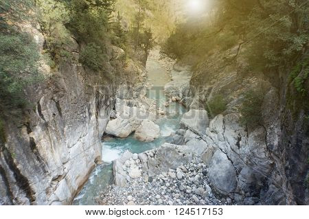 Mountain river flowing through a canyon in the summer.