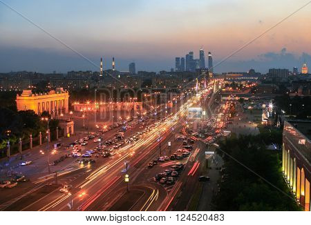 Krymsky Val Street, traffic, entrance arch in Gorky Park in Moscow night, Russia