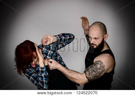 Muscular Bearded Man Beating His Redhead Wife.