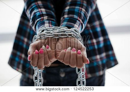 Hands Tied By Chain